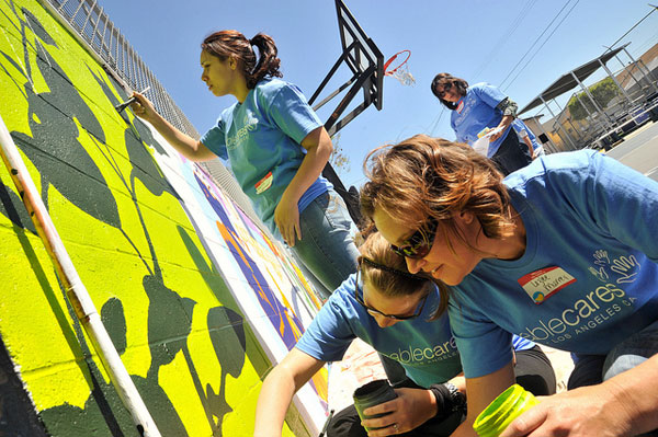 volunteers paint mural